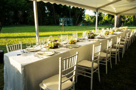 outdoor event: Luxury wedding lunch table setting outdoors Stock Photo