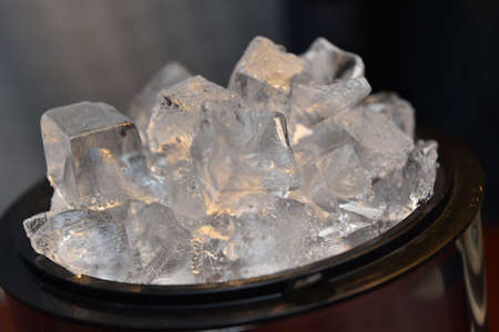 ice tongs: Ice cubes in the bucket
