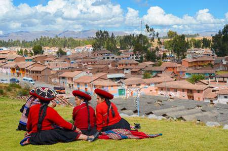 CHINCHERO, PERU- JUNE 3, 2013: Native Cusquena women dressed in traditional colorful clothing