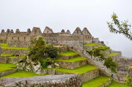 cusco region: MACHU PICCHU, CUSCO REGION, PERU- JUNE 4, 2013: Details of the residential area of the 15th-century Inca citadel Machu Picchu