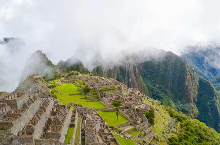 cusco region: MACHU PICCHU, CUSCO REGION, PERU- JUNE 4, 2013: Panoramic view of the 15th-century Inca citadel Machu Picchu Editorial