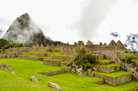 MACHU PICCHU, CUSCO REGION, PERU- JUNE 4, 2013: Panoramic view of the 15th-century Inca citadel Machu Picchu.