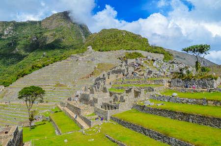MACHU PICCHU, CUSCO REGION, PERU- JUNE 4, 2013: Panoramic view of the 15th-century Inca citadel Machu Picchu Editorial