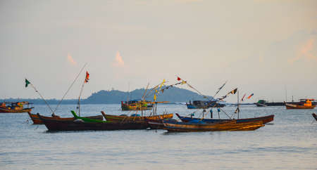 NGAPALI, MYANMAR- SEPTEMBER 27, 2016: Traditional burmese boat at sunset