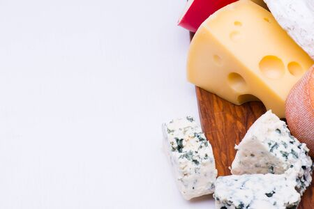 product range: Cheeses on chopping board on white background Stock Photo