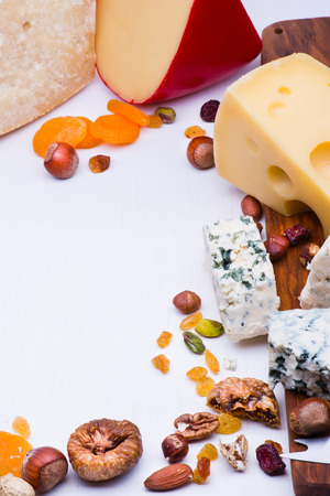 gamme de produit: Cheeses with dried fruits and nuts on wooden board
