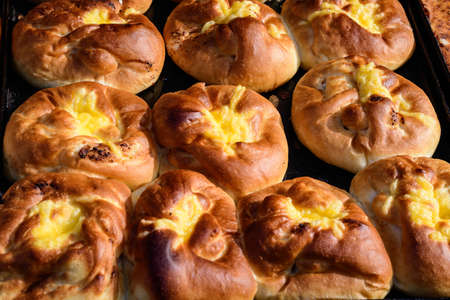Freshly cooked traditional salted cheese pies called