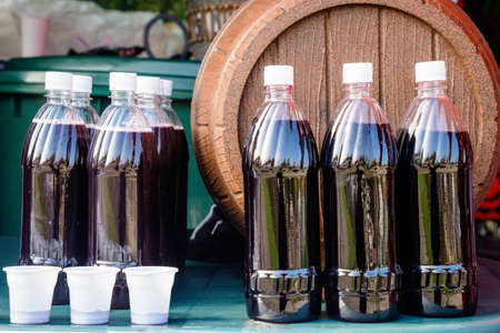 Plastic bottles and glasses with freshly squeezed grape juice during a food and wine festival in Bucharest, Romania