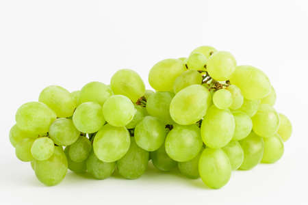 One bunch of ripe organic white grapes isolated on white background, side view