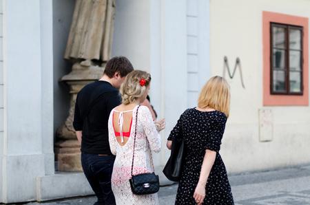 czech women: Prague, Czech Republic - July 6: Two women and the man walk along the street on July 6, 2015 in Prague, Czech Republic. Editorial