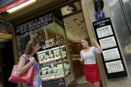 czech women: Prague, Czech Republic - August 2: Two women talk on the street outside the store on August 2, 2015 in Prague, Czech Republic