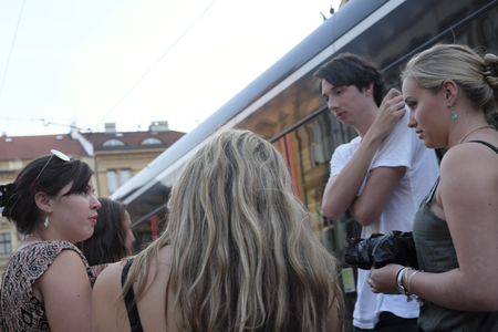Prague, Czech Republic - October 13: A group of women talk at a tram stop on October 13, 2015 in Prague, Czech Republic.