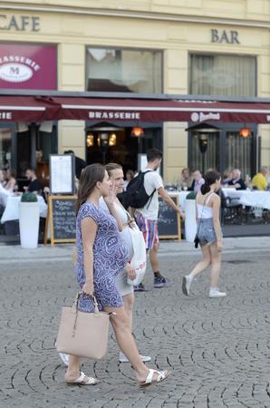 czech women: Prague, Czech Republic - June 30: Two pregnant women walk along the street on June 30, 2015 in Prague, Czech Republic. Editorial