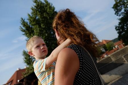 czech women: Prague, Czech Republic - July 24: The mother goes and carries his son on July 24, 2015 in Prague, Czech Republic