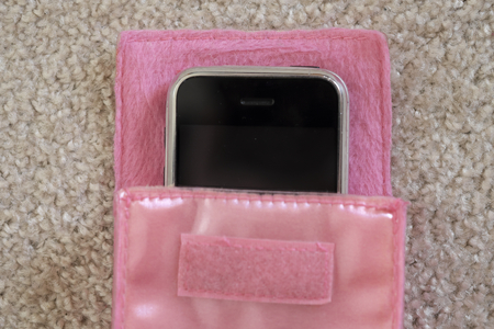 parfum: The mobile phone in the pink case and around is parfum and sweet