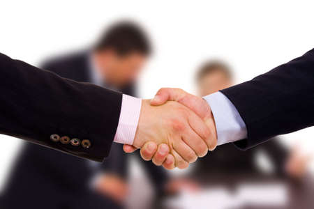 Closeup of business people shaking hands at the office photo