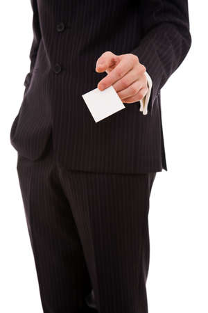 Businessman handing a blank business card over white photo