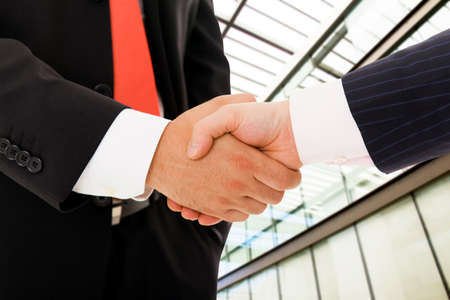 Closeup picture of businesspeople shaking hands, making an agreement at the office.