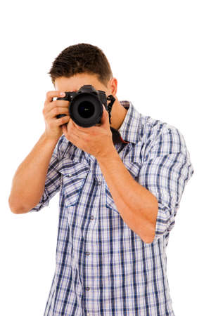 Young photographer with camera, isolated on white photo