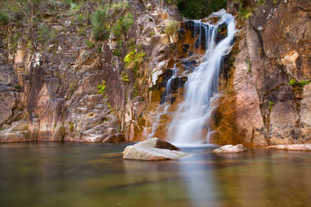 Deep forest Waterfall in Geres national park, north of Portugal. photo