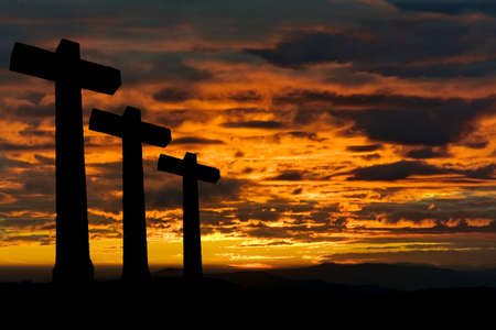 crosses silhouette against the sky at sunset photo