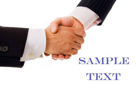 Business men handshake against white background Stock Photo - 18748823