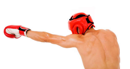 Young Boxer fighter with boxing helmet and gloves making a punch over white background photo