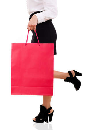 View of elegant woman carrying red shopping bag Stock Photo - 18748976
