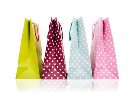 Assorted colored shopping bags on white background