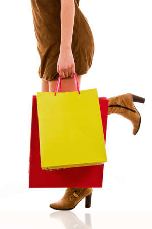waist-down view of woman carrying shopping bags