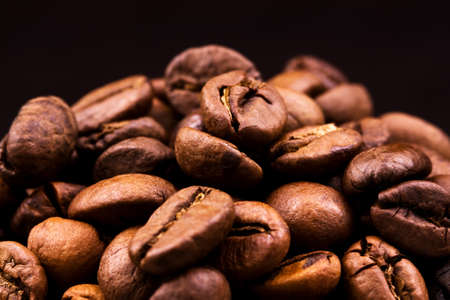Heap of burnt brown arabica coffee beans