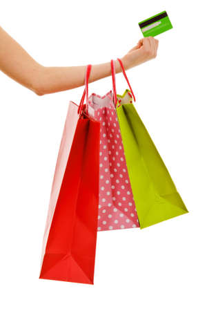 Female hand holding shopping bags and credit card photo