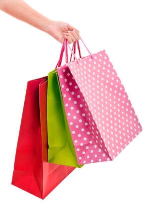 Female hand holding colorful shopping bags photo