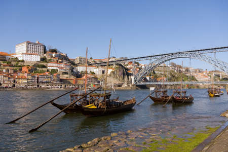 Rabelo boats near Dom Luis Bridge ( oPorto ) -  north of Portugal 免版税图像