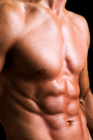 body male: Perfect male torso against black background Stock Photo