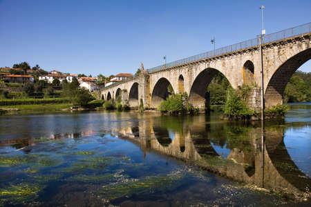 lima province: Bridge of Ponte da Barca, ancient portuguese village, on Minho river, north of Portugal Stock Photo