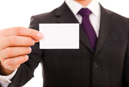 Close-up of business card in business man hand