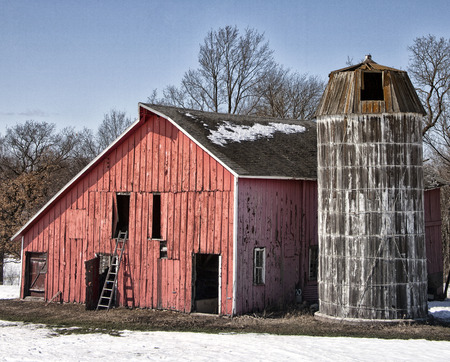 farmstead: Landscape springtime image of an old farmstead, with weathered barn with wooden silo. Springtime in Wisconsin