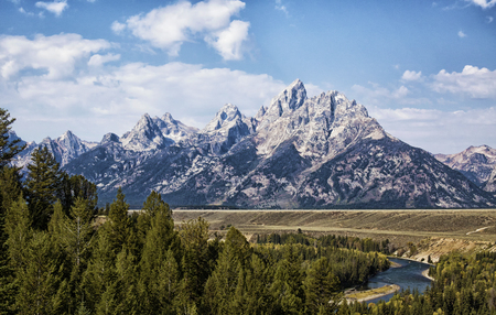 Grand Tetons, with the Snake River in the foreground.