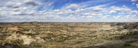 blue clouds: Panorama of the badlands of Theodore Roosevelt National Park.  Medora, North Dakota