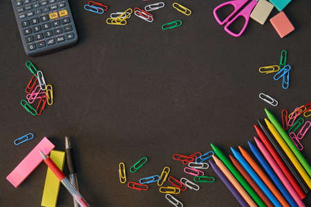Colors and school supplies on black background Imagens