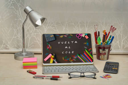 Childrens desk prepared with the necessary for the return to school