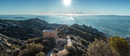 Panoramic at sunrise of one of the several hermitages in the mountain of Montserrat Фото со стока