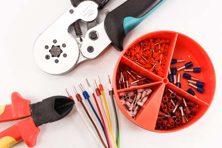 crimping: Crimping tool and accessories for cable wiring. Stock Photo
