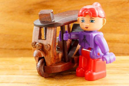 tuk: Tuk Tuk wood toy with plastic girl Stock Photo