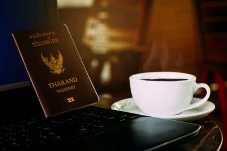 world of work: Coffee cup with laptop and passport