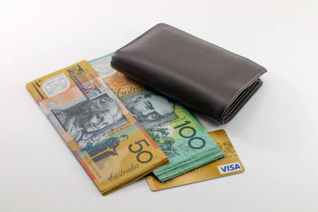fifty dollar bill: one hundred, fifty australian dollar bill wallet and gold credit card, isolated on white background Stock Photo