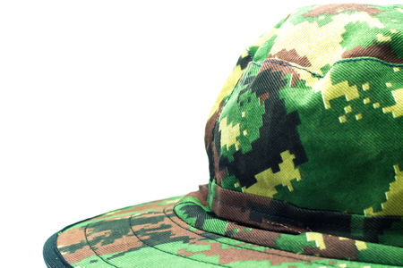 cryptic: Army green camouflage helmets for use in the forest.