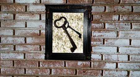 Old frame with keys on the wall
