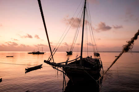 Boats in the Banda Sea at sunset 스톡 콘텐츠